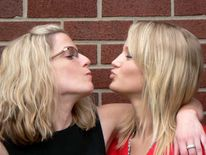 mother daughter kiss