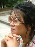 Loony  cute Oriental girl with thick lens drop temple glasses