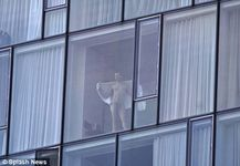 it clear he's not shy about being spotted naked at his bedroom window