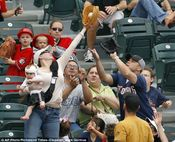 Good catch! Mom with a baby in one hand catches foul ball with the