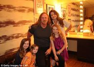 Country singer Trace Adkins' wife and children flee as their family
