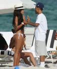 Puppy love? Angela was joined on the beach by her ex boyfriend, rapper