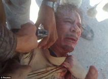 Gunshots, then silence: Is this the moment Gaddafi was killed by a