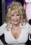 Dolly Parton reveals new flower tattoo nestled between her bosom at