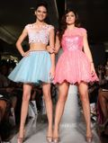 Kendall and Kylie Jenner model in the Catwalk for Sherrie Hill at New