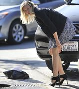 Coming undone: Amy Smart was spotted tying her shoelaces in West