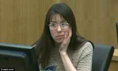 Focused: Jodi Arias, pictured in court today, watches a police officer