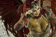 The breast party in Brazil: Dressed in little more than feathers and