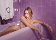 Chloe Sevigny poses naked in the bath with only a few strategically