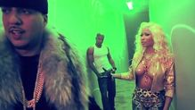 Nicki Minaj appears topless with just starshaped pasties protecting