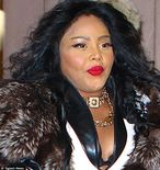 The everchanging face of Lil' Kim: Queen Bee goes on the promo trail