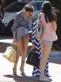 Khloe Kardashian's nude Spanx exposed as her mini dress blows up in a