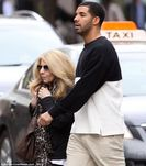for a stroll with his diminutive mother Sandy in Toronto | Mail Online