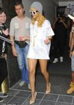 Rihanna wears a white Tshirt as a dress with nude heels on the way to