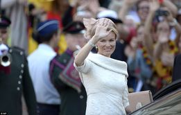 Glamorous: The new Queen Mathilde looked stunning in a cream dress and