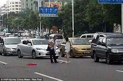 China couple strip naked in middle of road | Mail Online