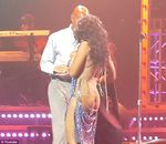 Toni Braxton wardrobe malfunction: skimpy dress slides down to expose