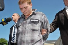 Accused: Maxwell Sherman, 18, leaves Nassau County Police Headquarters