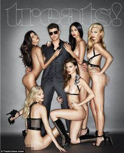 What a treat: Robin Thicke poses on the cover of Treats! magazine with