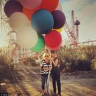 Heidi Klum and her mother Erna hold tightly to massive balloons on
