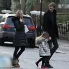 Abbey Clancy hides bump on day out with husband Peter Crouch and