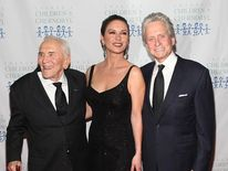 Kirk Douglas, Catherine ZetaJones and Michael Douglas attend the 2011