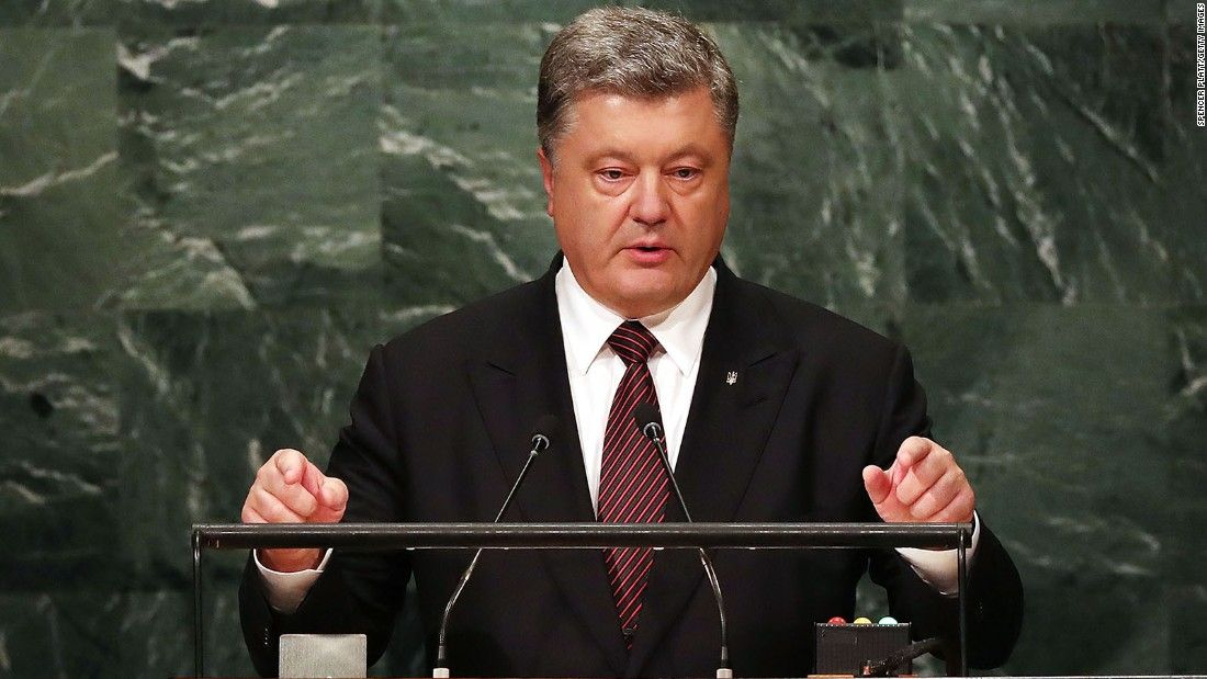 Ukrainian leader, a Russian adversary, gets low-key welcome