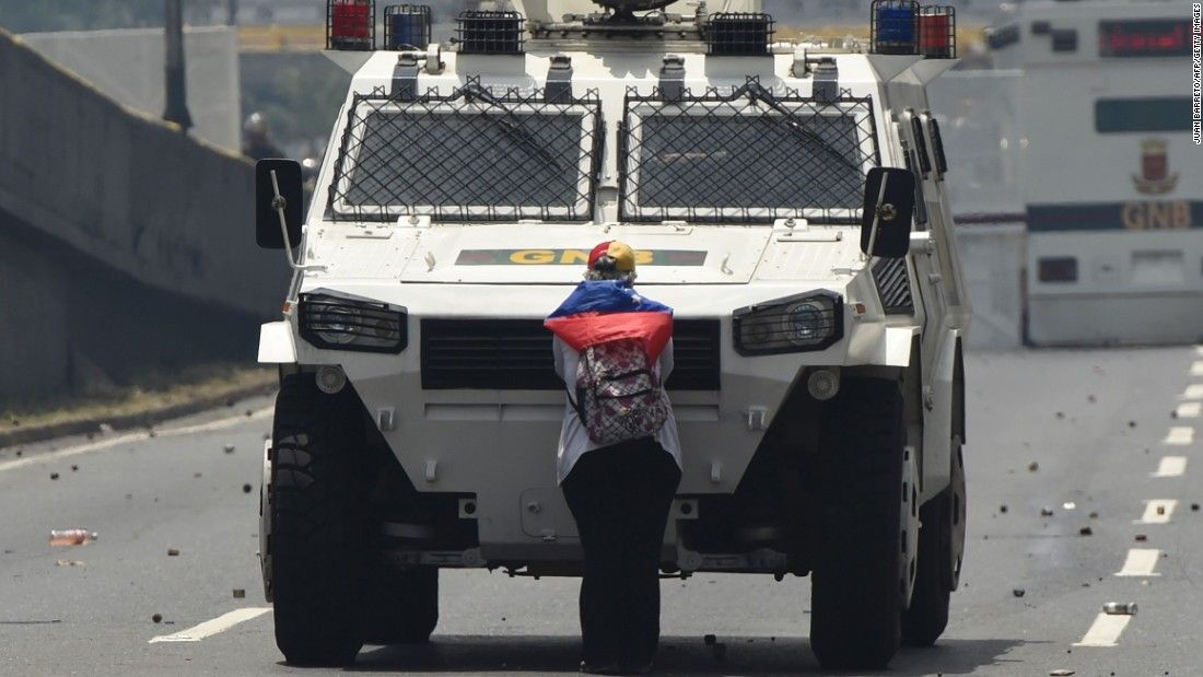 Woman stands down armored truck