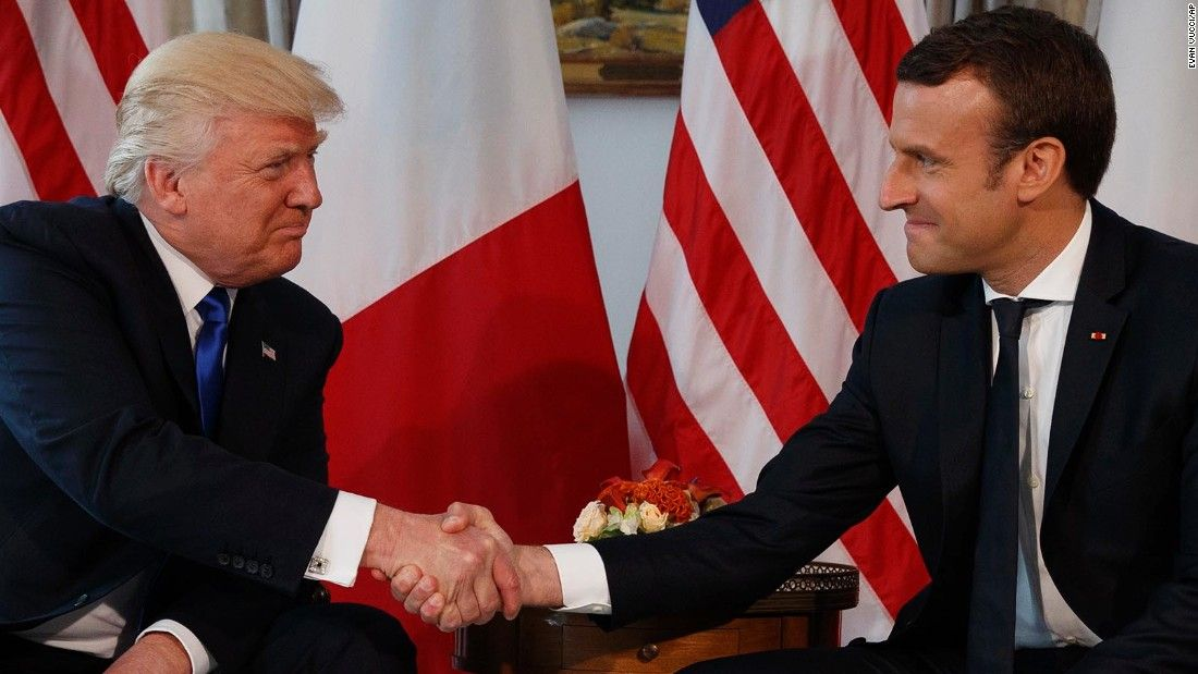 Trump and Macron exchanged a white-knuckled handshake