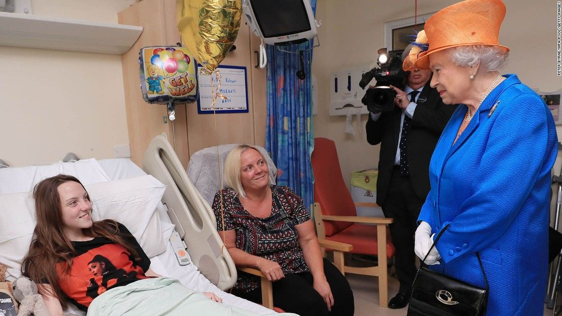 Queen visits victims of 'very wicked' attack