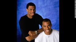 Collins and his twin brother, Jarron, pose for a portrait during the