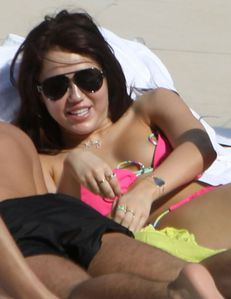 miley-cyrus-nipple-slip-bikini-1-03 jpg picture by kostasny4