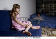 girl, father attempting to discipline his daughter  stock photo