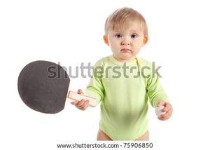 stock photo beautiful baby with table tennis racket Save to a lightbox