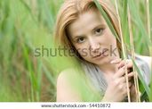 stock photo : beautiful teen blond girl at the meadow  Save to a