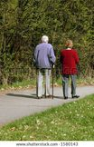 ShutterStock Old couple walking together in park 1580143