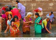 Colorful Hindu Women Bathing In The Ganges In Varanasi Stock Photo