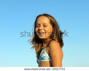 Beautiful Sunbathed Girl Teenager In A Bathing Suit Stock Photo