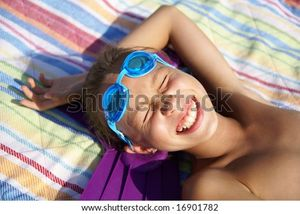 Preteen Girl Enjoying Sun-Bath On Sea Beach Stock Photo 16901782