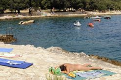 rock and pebble beach on the croatian island of rab croatia nude