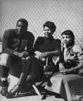 Baseball great Jackie Robinson (in football uniform) w  wife Rae