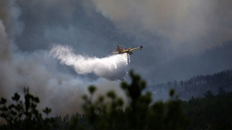 Waterbombing plane fighting huge wildfire crashes in central Portugal