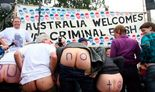 Australia Welcomes 'War Criminal Bush' with bare asses