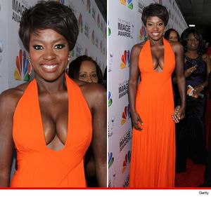 Viola Davis in a plunging low cut orange dress showed off some MAJOR