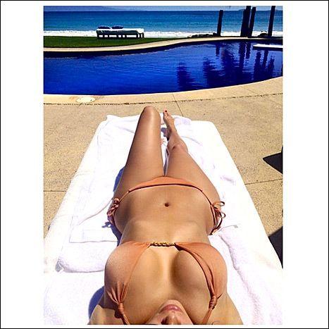 Kim Kardashian Strips Down To Cleavage Baring Bikini On