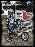 8yr old Diego Cortes about to start riding his custom black 50cc KTM