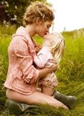 mother daughter kiss | Motherhood