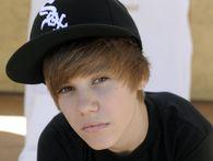 Simon Cowell sued over criticizing contestant; Justin Bieber to appear