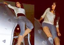 The pictures show Katrina performing a stunt on top of a metal edifice