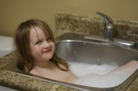 The author's daughter wanted to take a bubble bath but the tub had